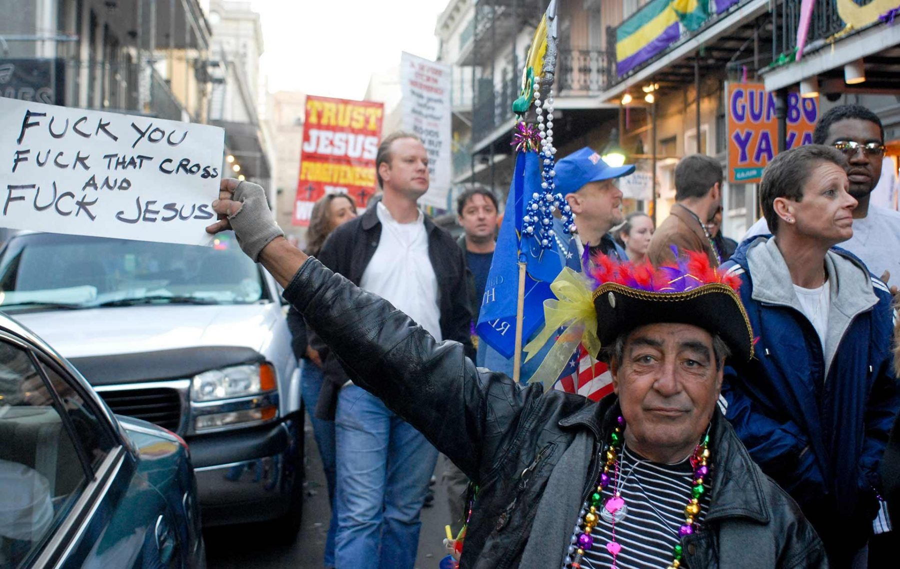 A man in a wheelchair with opinions about Christianity at Mardi Gras in New Orleans. USA