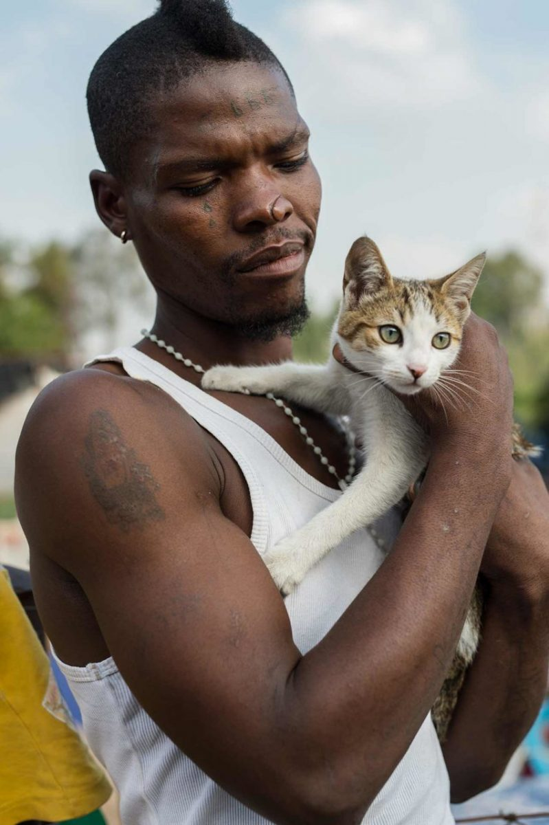A resident of the Randfontein dump with his cat, Freedom. South Africa.