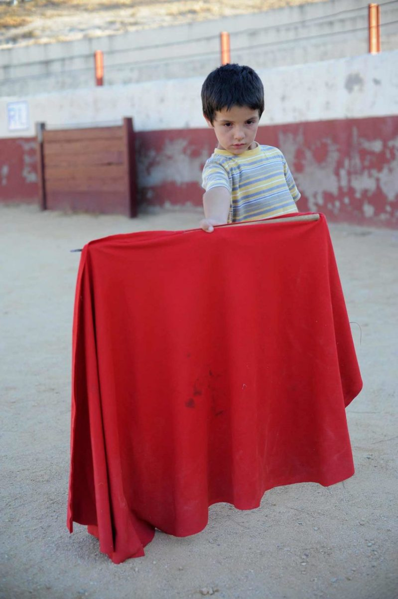 A young boy at a bullfighting school. Spain.