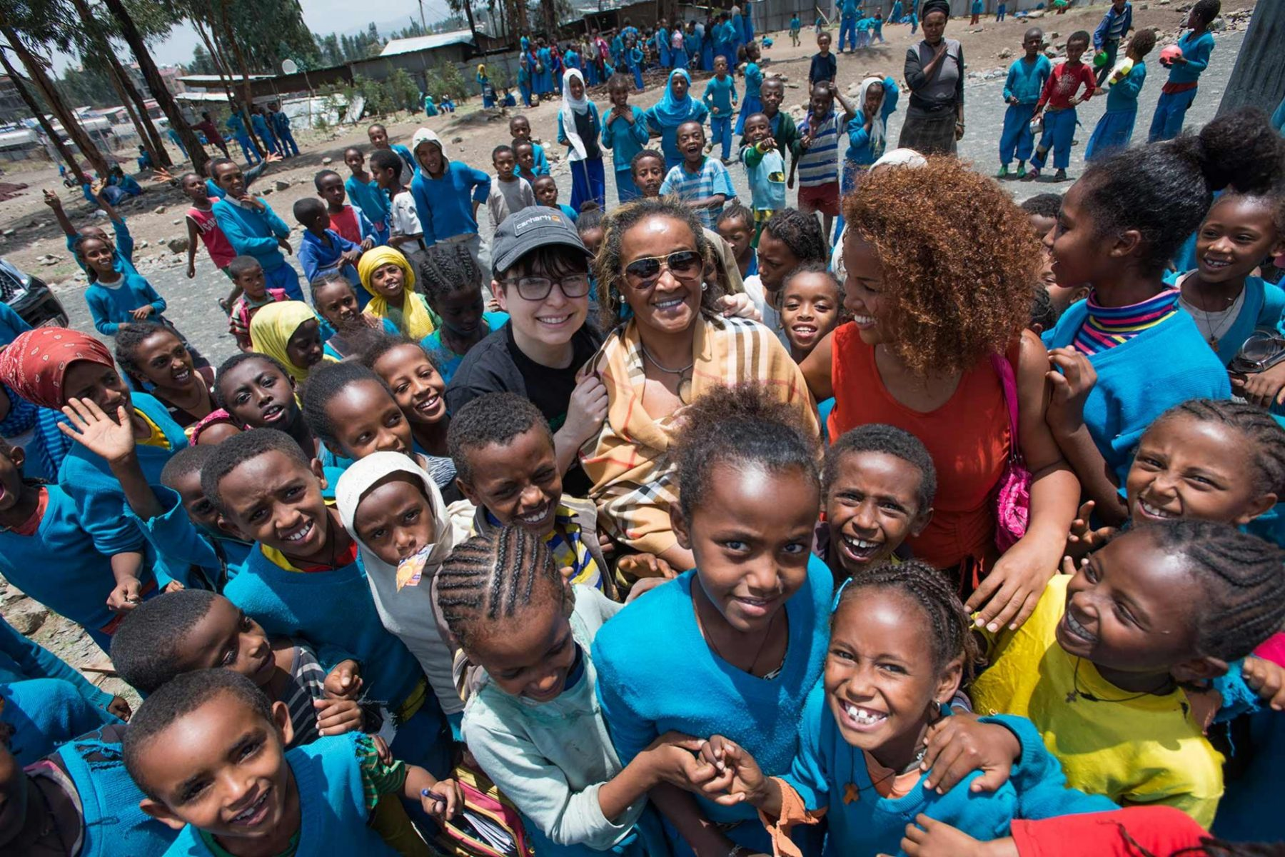 Dawn Moncrief (L), founder of A Well-Fed World, with Seble Nebiyeloul (R, sunglasses), founder of International Fund for Africa. Both of their organizations bring plant-based nutritious foods to schools in Africa. Ethiopia, 2016