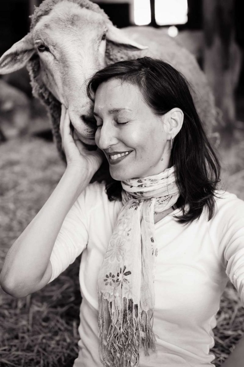 Psychologist, author, and founder of Beyond Carnism Melanie Joy with a sheep friend at Farm Sanctuary. USA, 2015.