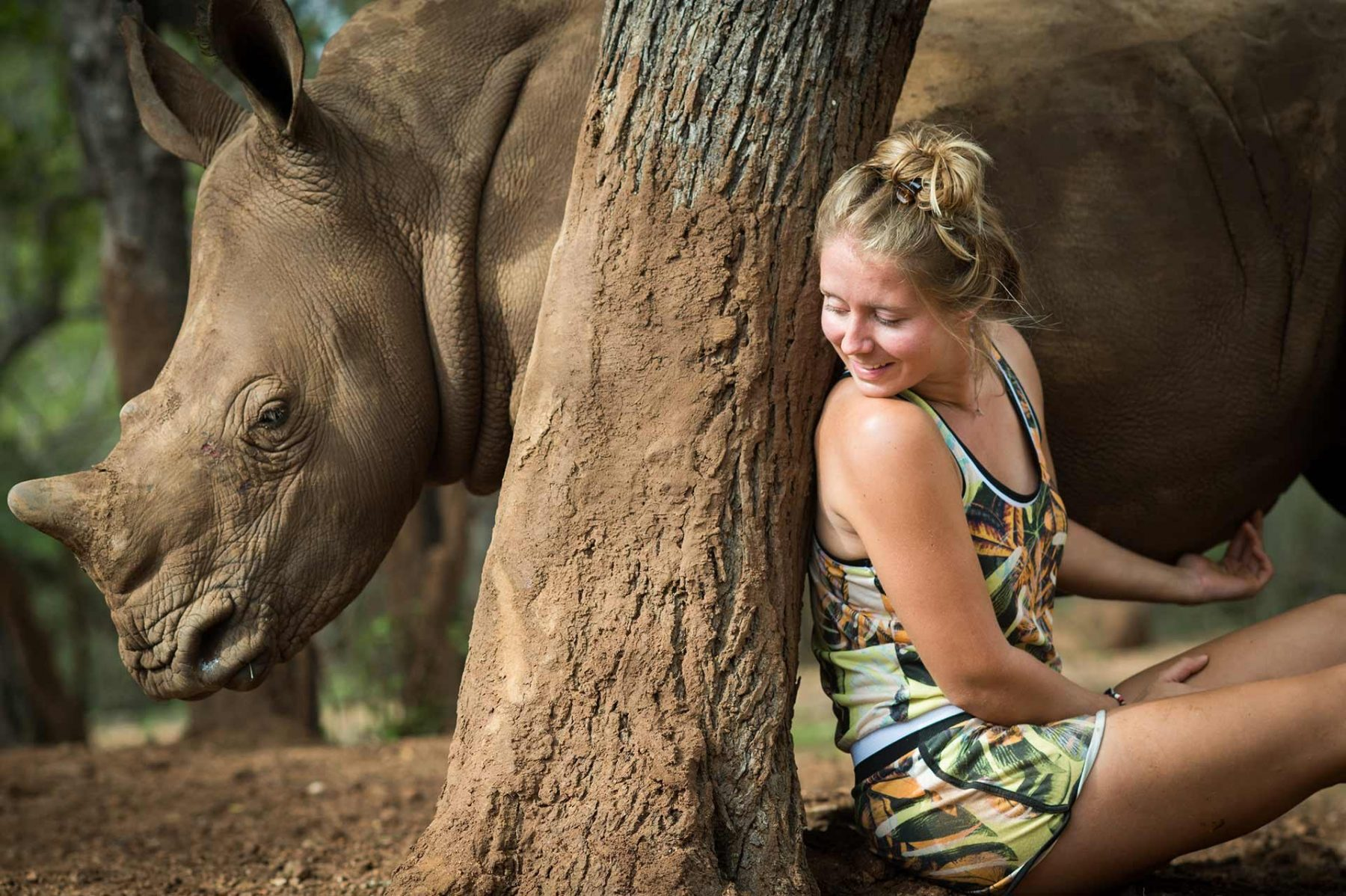 Jade Aldridge at Rhino Revolution with a young rescued rhinoceros, whose mother was killed by poachers. South Africa, 2016
