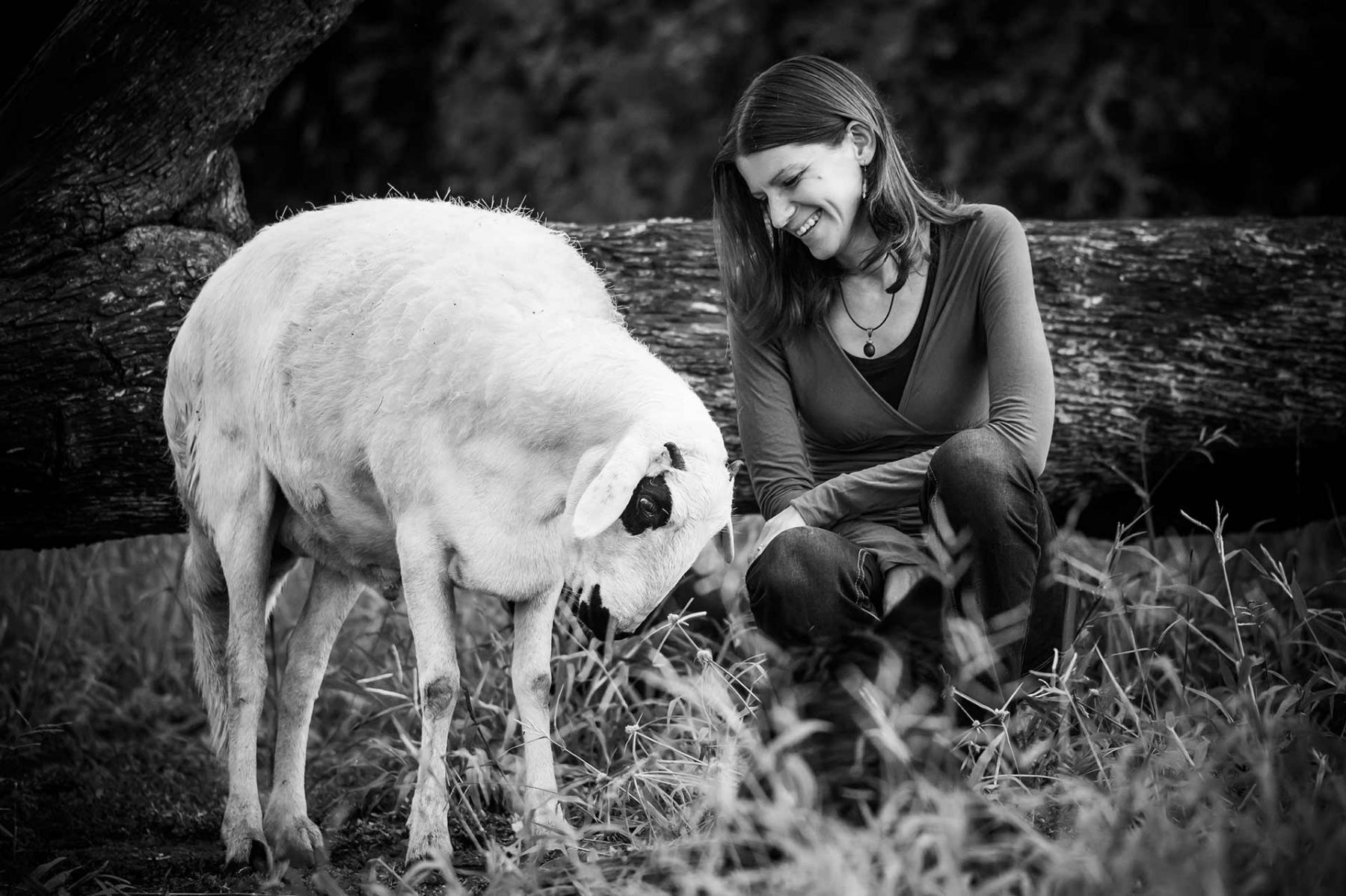 Co-Director and Rehabilitator Josie du Toit at the Vervet Monkey Foundation, posing with Basil the sheep. South Africa, 2016
