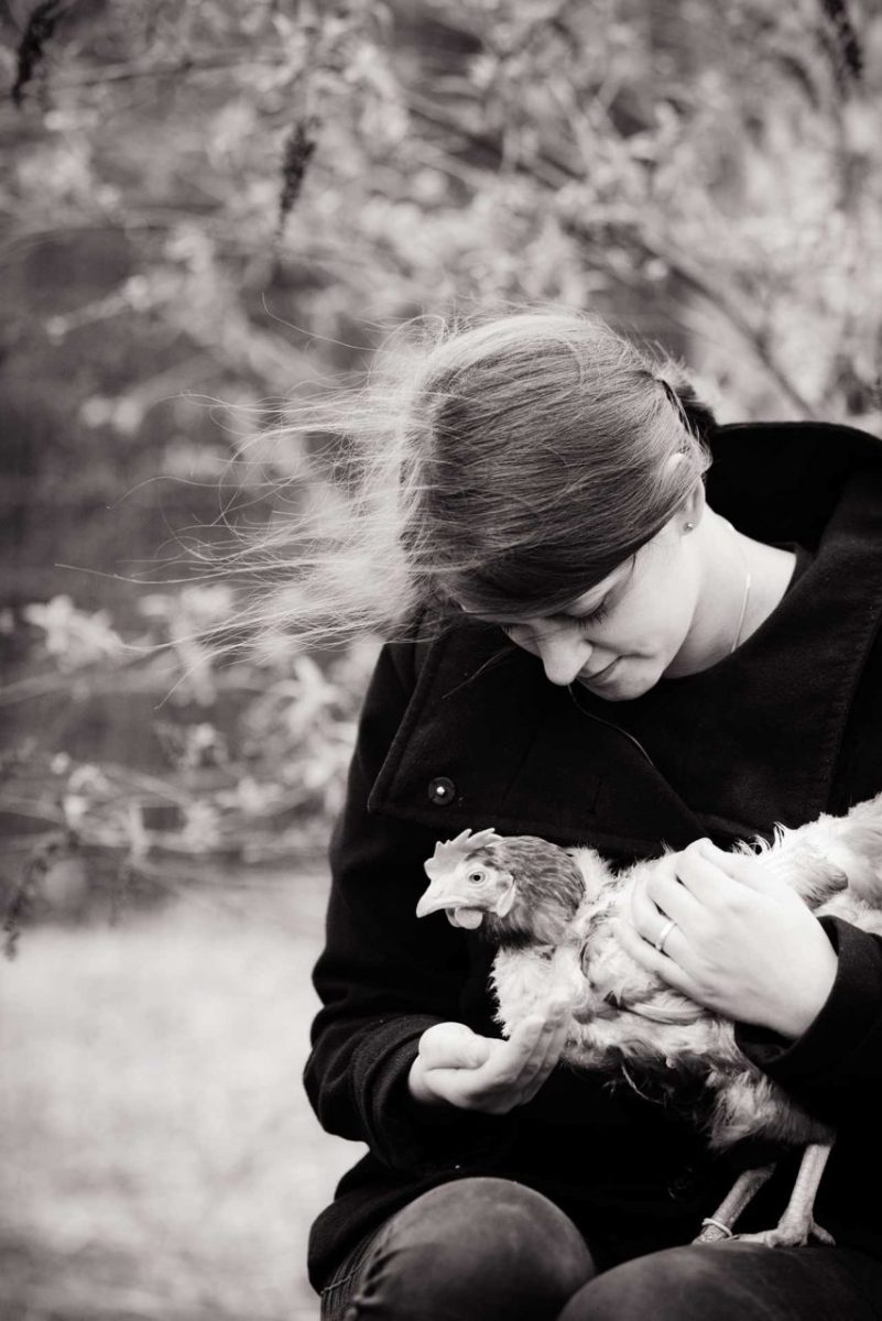 Lina Lind Christensen with a rescued hen at her sanctuary, Frie Vinger (Free Wings). Denmark, 2015
